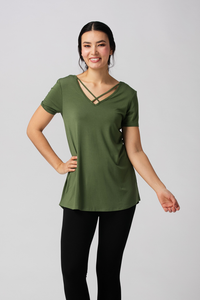 The Bamboo Kimberly tunic is both casual and comfortable, it features a high low hem, flattering Vneck with cross details and a scoop neckline at the back. Wear your Kimberly tunic with a pair of white jeans or some leggings to run errands. Willow Green Fabrication: 95% Viscose from Bamboo, 5% Spandex $38.49