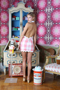 Paige Reifler in a gingham halter pink dress