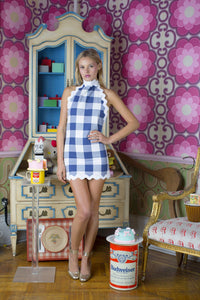 Paige Reifler in a gingham halter blue dress.