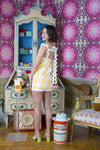 yellow ric rac and gingham dress with a bow