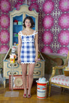 blue ric rac and gingham dress with a bow