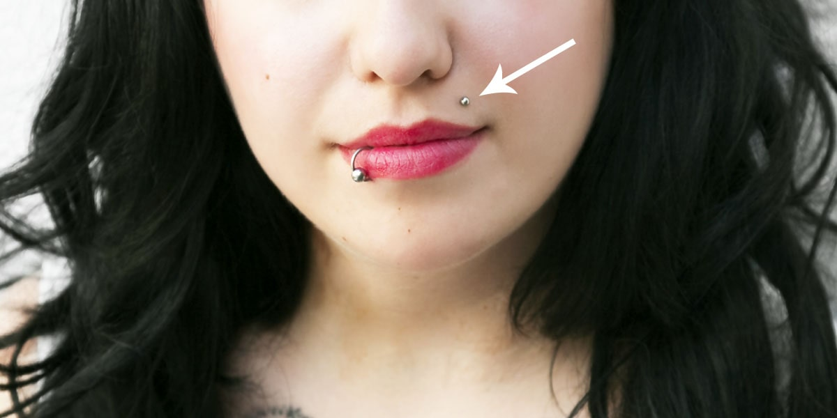 Woman with monroe piercing and lip piercing