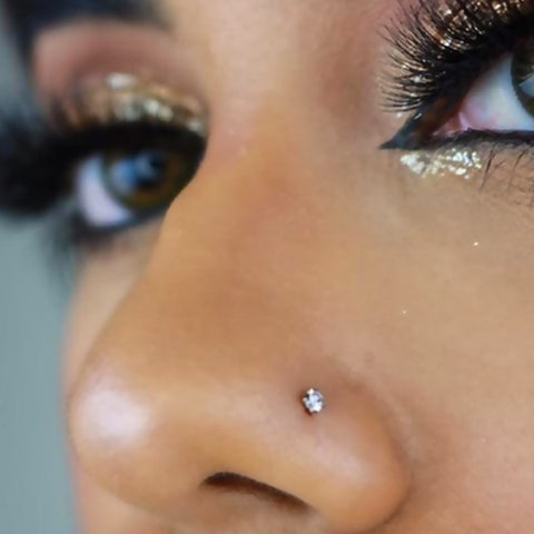 Model with nose stud, nostril piercing