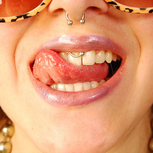 Woman with smiley and septum piercing