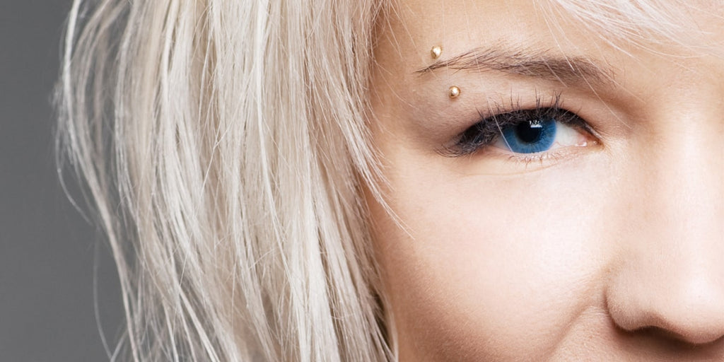 Blonde woman with eyebrow pierced