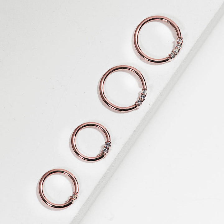 Rose gold diamond front facing seamless hoop rings