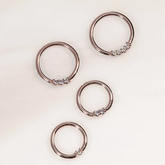 Rose gold, diamond front facing seamless hoop rings