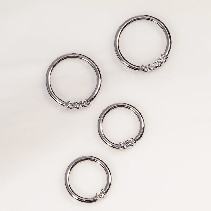 White gold, diamond front facing seamless hoop rings