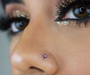 Model wearing purple flower gem nose stud