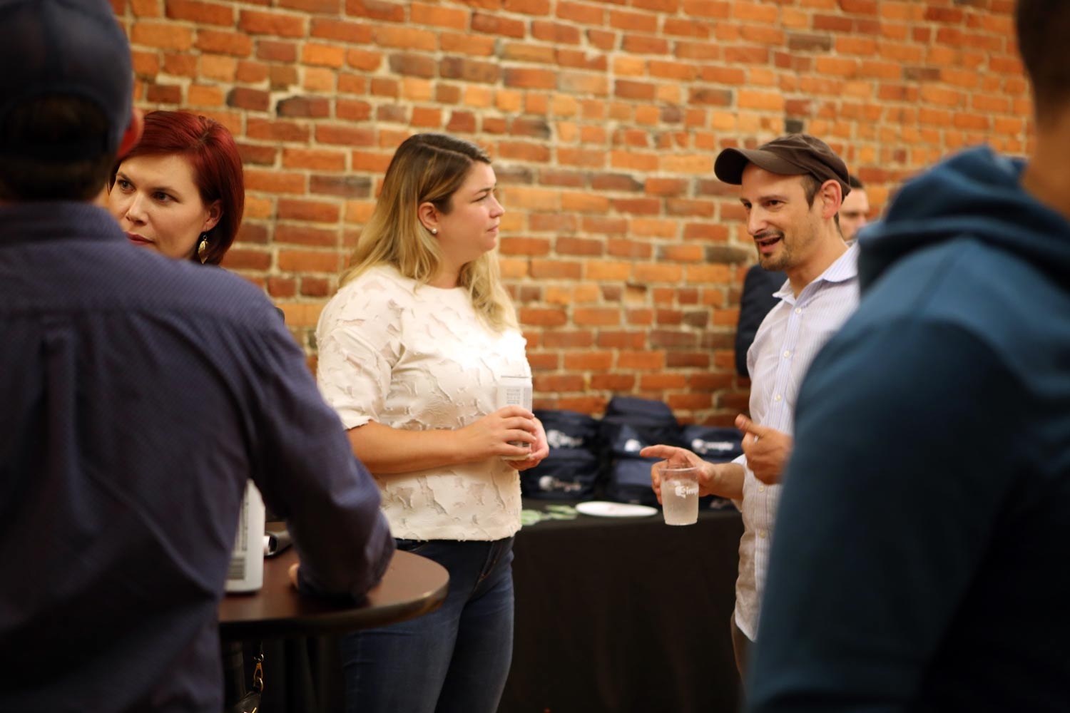 Speakers Sam Mundell and Daniel Steinberg talk before their presentations at the Shopify Meetup Columbus