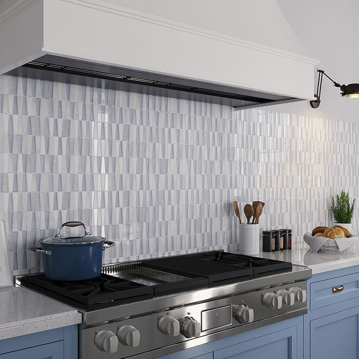 Fabrique Triangle Mosaic Grey Blue Glass Tile backsplash is the perfect finishing touch for this modern kitchen