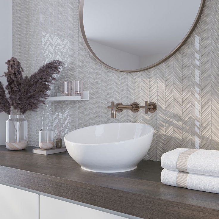 Scandinavian minimalist bathroom aesthetic - dark wood countertops paired with our Fabrique White Chevron Glass Mosaic Tile backsplash