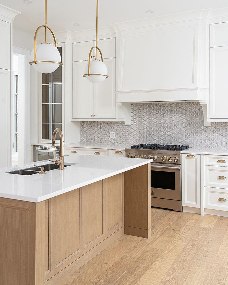 Custom kitchen with quartz countertops, and brass pendant lights with our Roman Flower Wooden Beige marble mosaic tile backsplash
