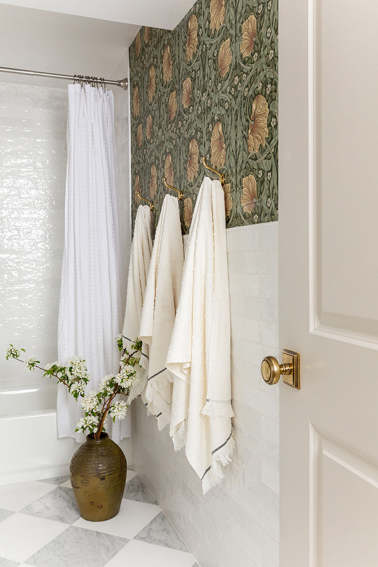Basement Bathroom Remodel with Marble Checkerboard Floor Tiles and Art Nouveau Floral Wallpaper