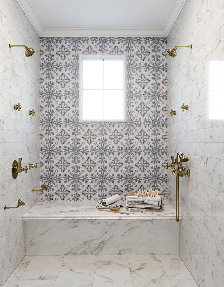 Marble Shower with White Floor Tiles and a Mosaic Wall Design