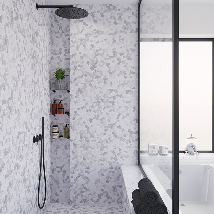River Pebble shower tile made of Carrara marble for an elegant spin on a rustic look