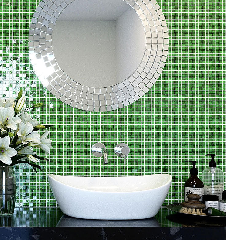 jade green glass mosaic tile backsplash will make you feel awake and alert even before you splash water on your face in the morning! The combination of iridescent glass and a lively green hue gives this modern bathroom the perfect mood-boosting ability!