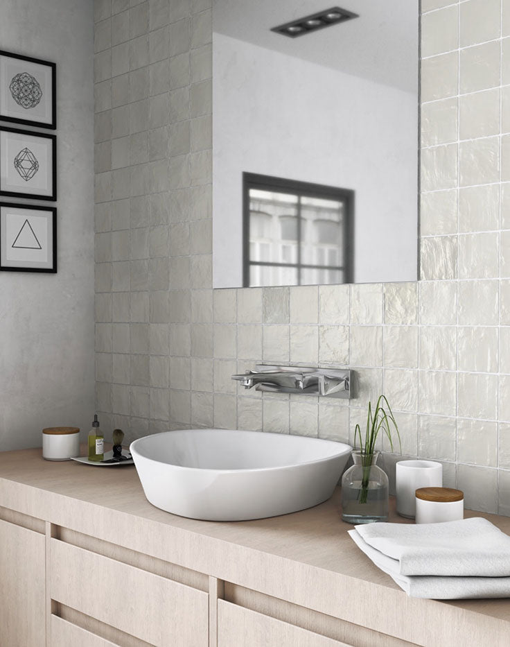 Neutral Scandi Bathroom Style with Light Wood Counters and Green Zellige Tiles