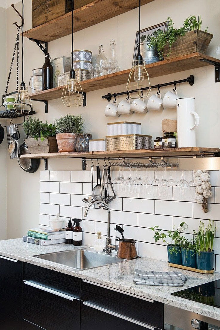 Rustic Industrial Jungalow Kitchen with White Ceramic Subway Tiles and Potted Plants