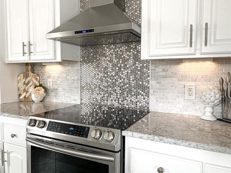 Mix and Match Kitchen Backsplash Tiles with Marble Brick and Stainless Steel Penny Tiles behind the Stove