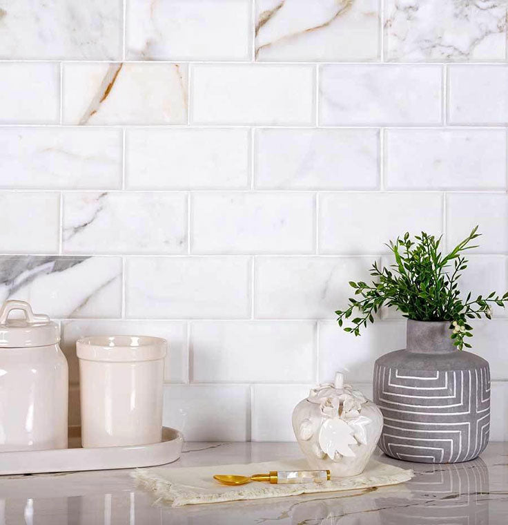 """If you like the beveled marble subway tile look, our Calacatta Gold 3"""" x 6"""" tiles add dimension"""