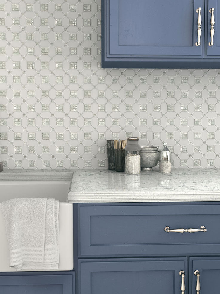 Dress up a white kitchen backsplash with decorative marble tiles and shell inserts