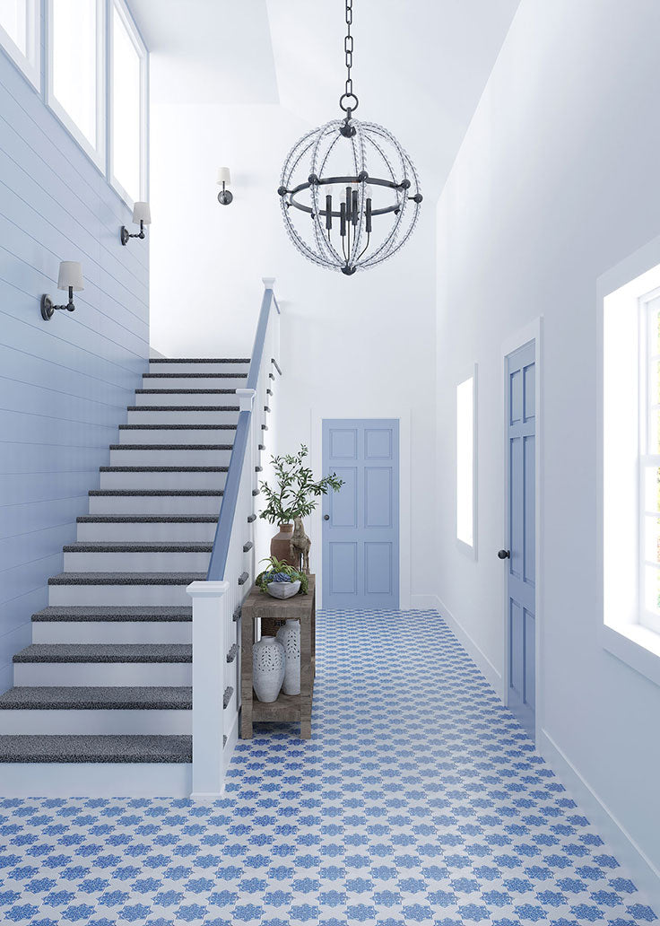The impact floor tiles can have on your interior is huge - how about this Mediterranean home with our Blue and White etched marble star and cross tiles?