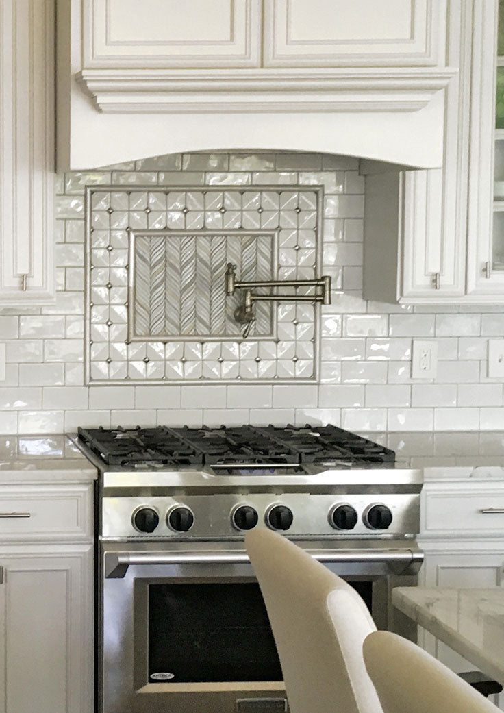 Decorative Tile Insert for a White Ceramic Backsplash with Subway Tile and Mosaic Patterns