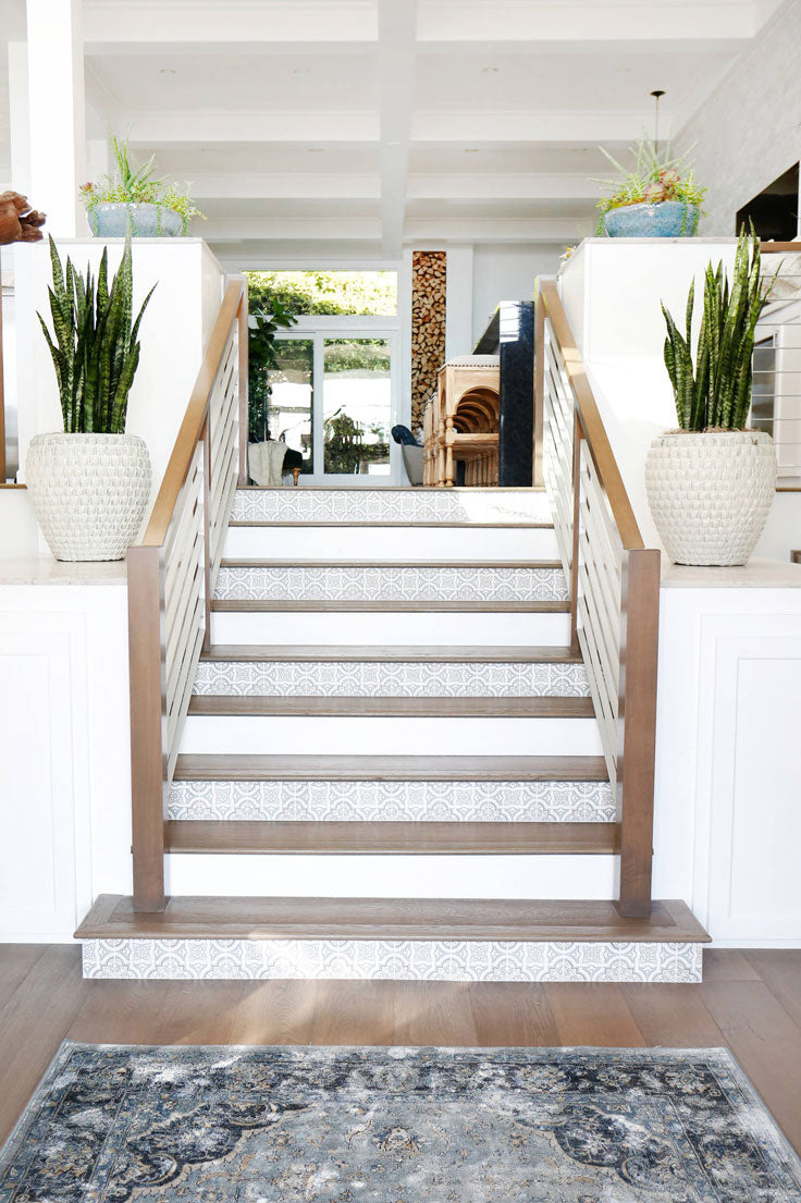Tile stair risers Inject a dose of style to this staircase design that reflects the modern coastal style of a Southern California home while bringing the whole theme together!