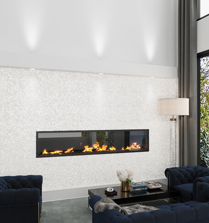 What a WOW moment! This Pure White Mother Of Pearl Herringbone Mosaic Tiled fireplace facing is a stunning way to create a glamorous living room design!