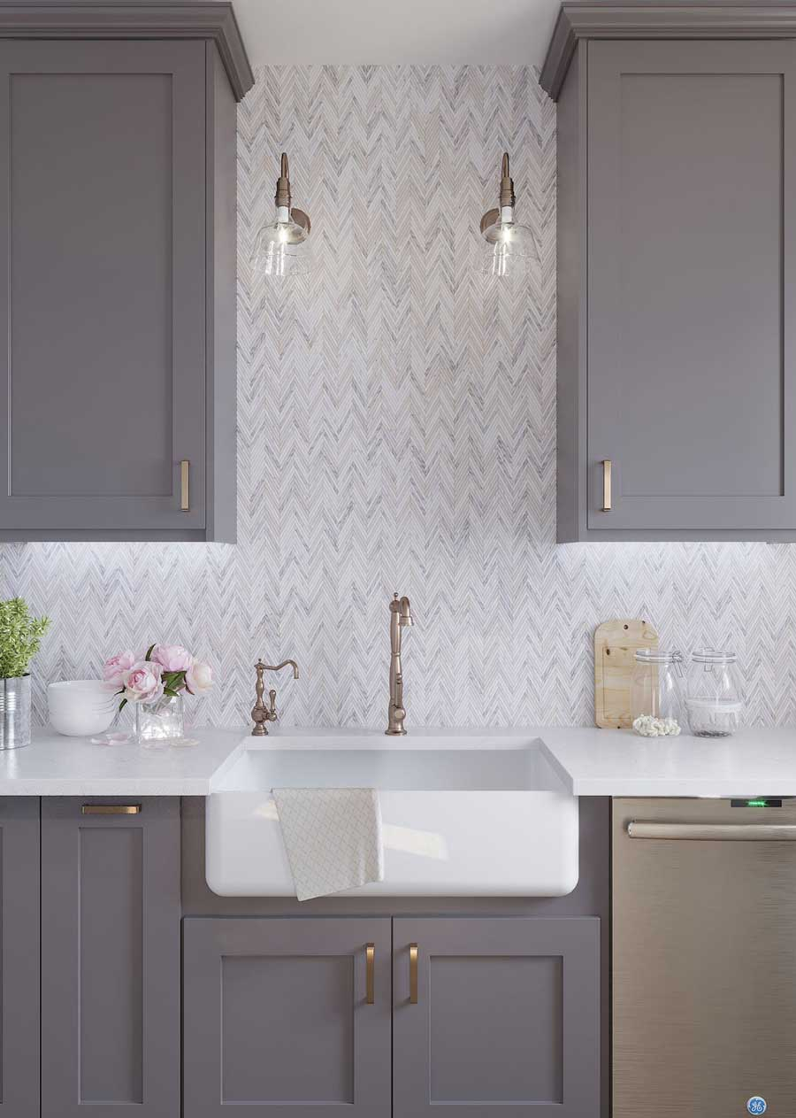 Modern farmhouse decor with a fireclay farm sink, neutral paint for your shaker cabinets and a Skinny Chevron Calacatta Gold Mosaic Tile backsplash!