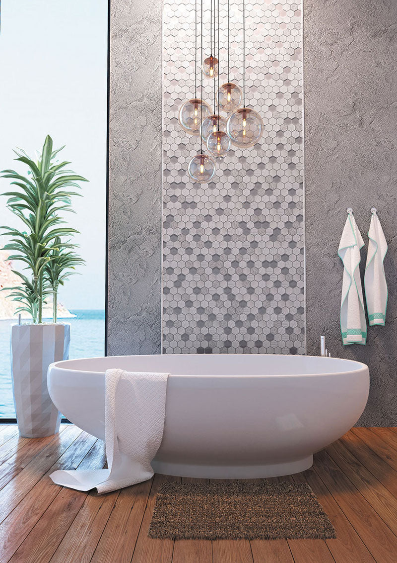 Contemporary Bathroom Design with a Hexagon Tile Accent Wall and Free Standing Tub