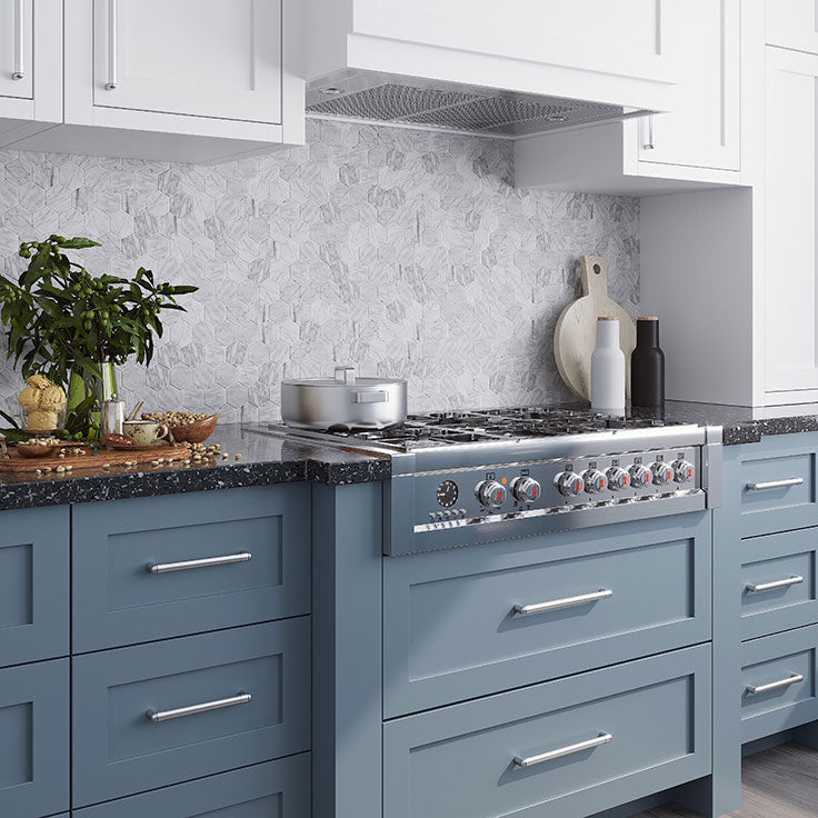 Peel and Stick tiles with genuine Carrara marble discs on an adhesive backing can be used behind the stove for a kitchen backsplash