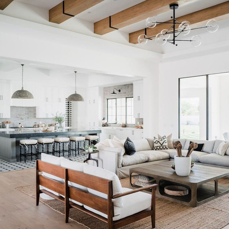 E&S Builders and The Lifestyled Co in Arizona created an open-plan living and kitchen area with unique flooring to define each space