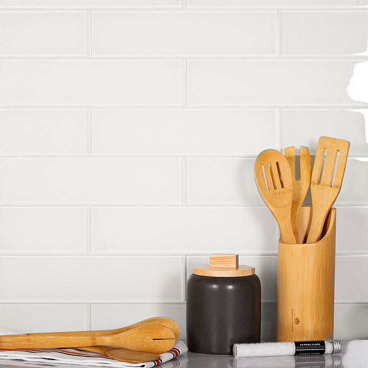 Classic white glass subway tiles are a staple of traditional kitchen design