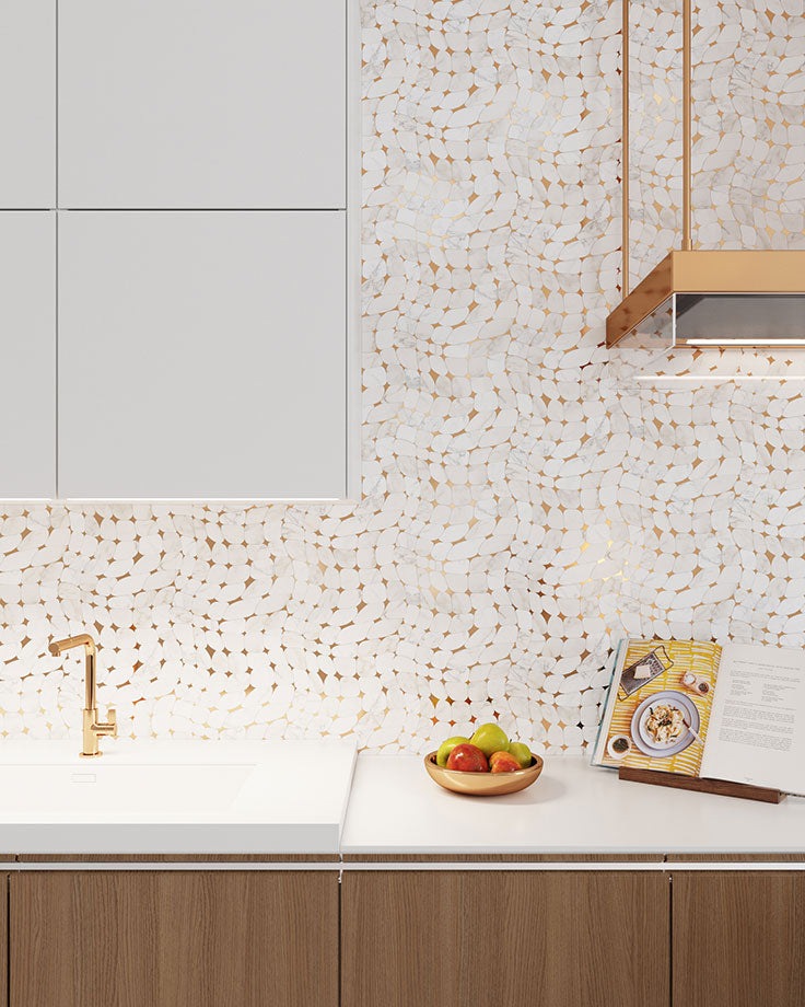 Brass Mosaic and Calacatta tile beautifully matches the warm tone of the wood cupboards