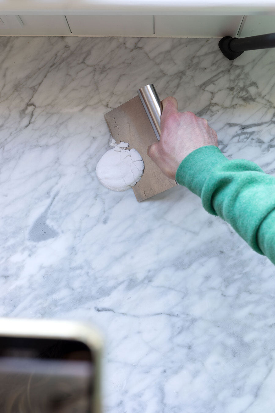 The Grit and Polish demonstrated how a DIY Marble Poultice removed stains from their marble countertop - it's that easy to make yourself!