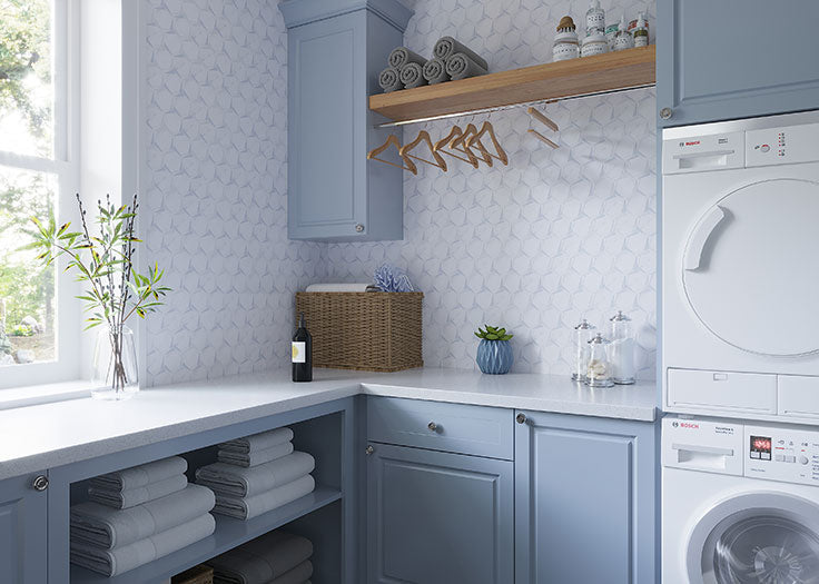 Dreaming of the perfect laundry room design? This blue and white backsplash has all the charm of wallpaper with a water-resistant and stunning marble mosaic wall!