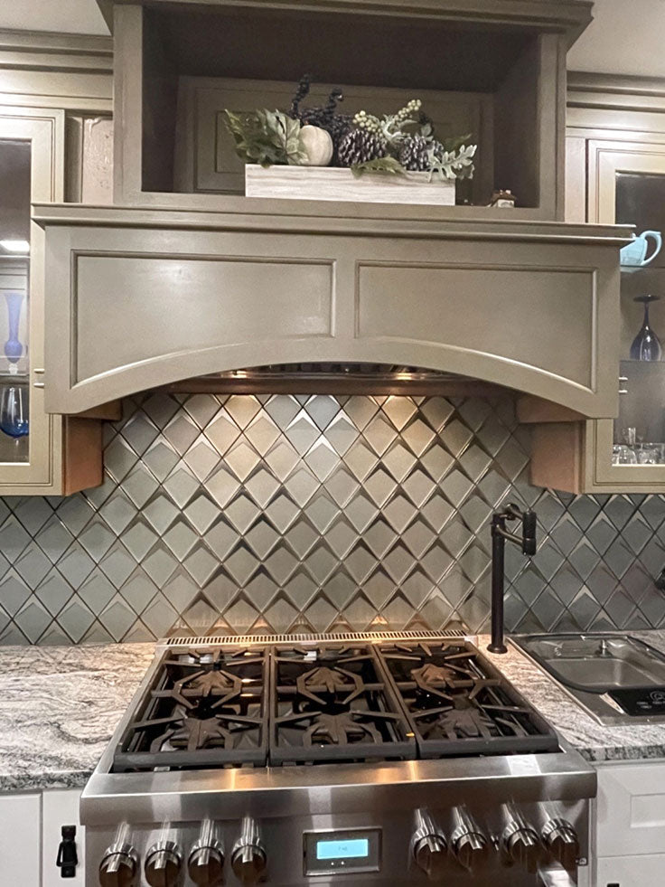 We love the way this gorgeous metallic chrome and Green Tile adds chic style to a classic country kitchen!