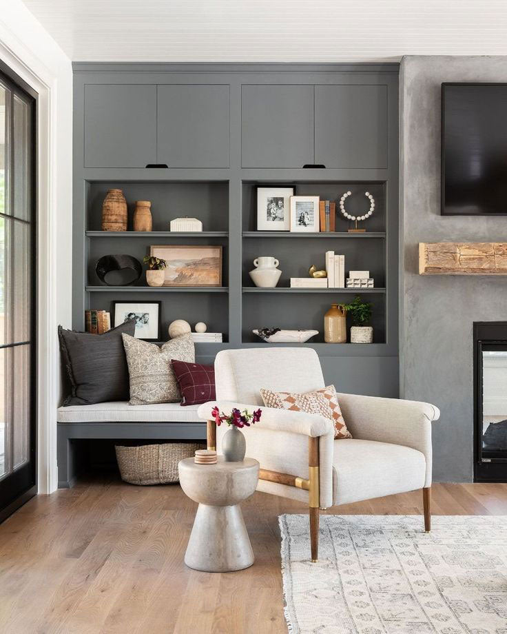 Studio McGee layered warm neutral colors in shades of gray to create this retro bohemian living room!