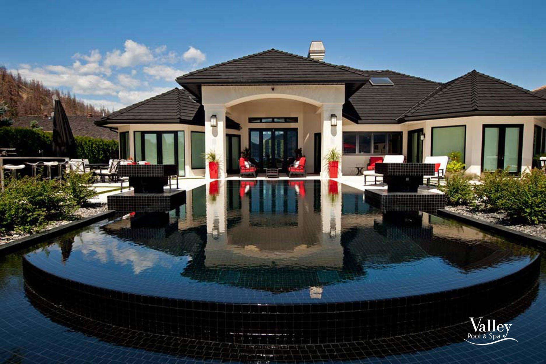 Black Pool Tiles add to a Modern Home Design and Backyard with Drama