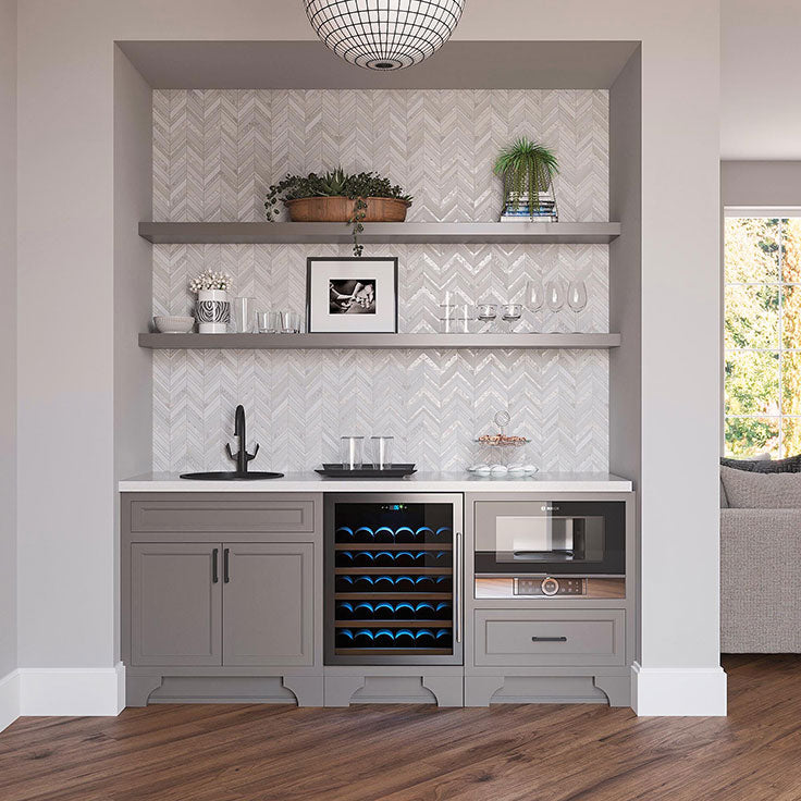 this built-in pantry gives an illusion that it's a separate space, and yet blends in effortlessly with the rest of the kitchen's architectural features.