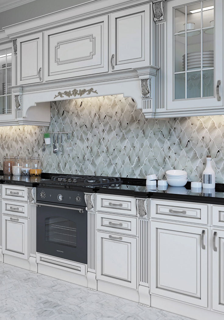 Give your kitchen a dash of old-world charm with the unique lantern pattern and dreamy color of this Ocean Glass Louvre Grey Mosaic Tile backsplash! The sea glass swirls are a beautiful addition to custom cabinetry in a black and white color scheme.