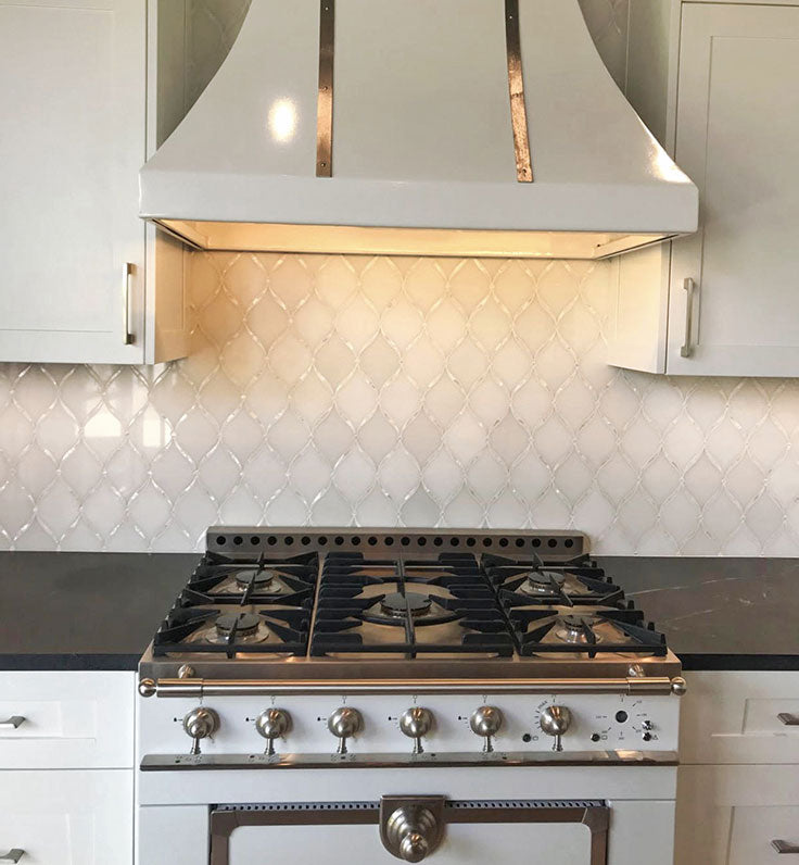 French Kitchen with a Vintage Range Hood and White Marble Shell Mosaic Tile Backsplash