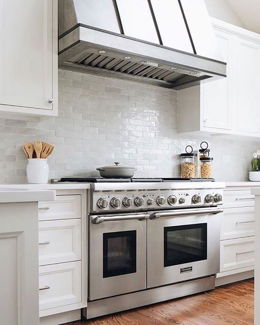 Keep your white kitchen light and bright with a textured ceramic subway tile backsplash that makes a small space feel larger