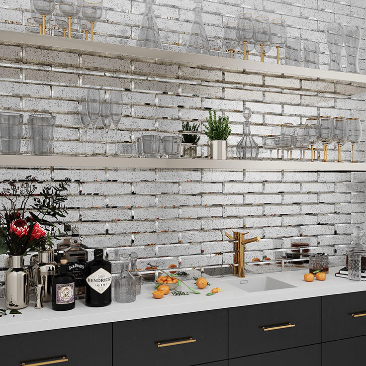 Adding Beveled Antique Mirror Glass Tile under your cabinets or behind your shelving will amplify the feeling of space even in a small storage space