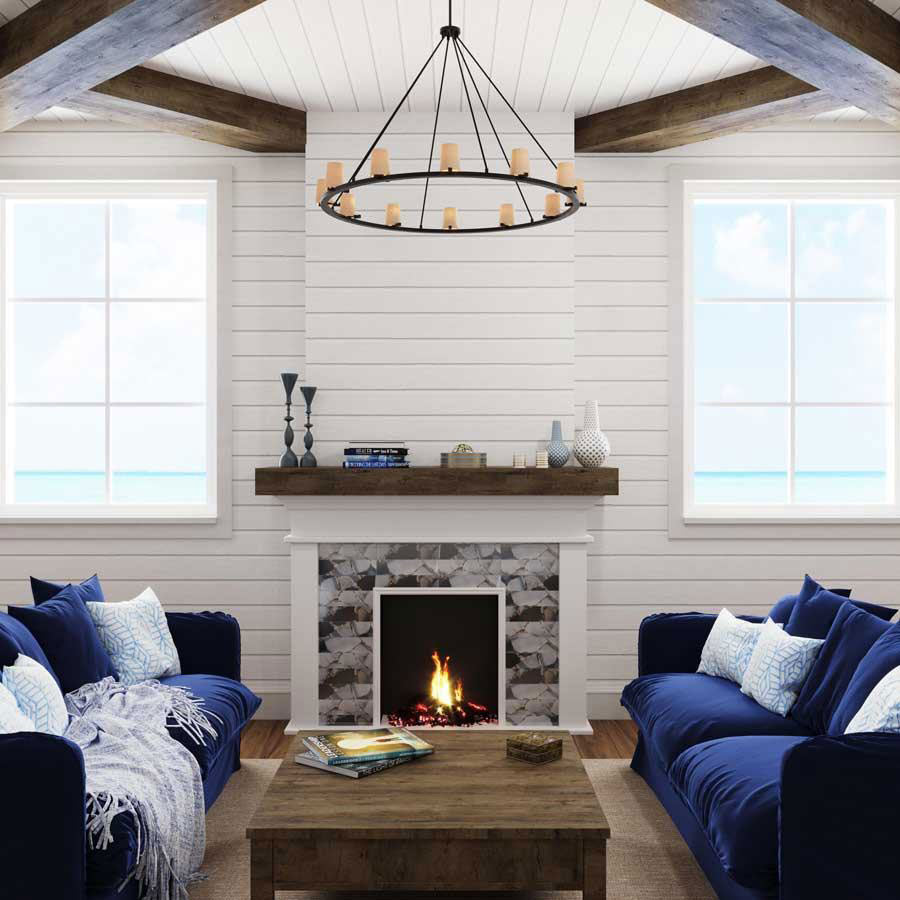 A tiled fireplace with Midnight Blue and Quartz Geode Glass adds to a nautical-style living room by adding navy blue colors to a tiled fireplace surround and playing off white shiplap walls and driftwood decor!