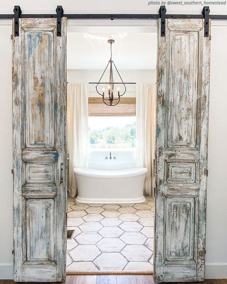 Antique Farmhouse Bathroom with Vintage Barn Doors and Whitewashed Wood Look Hexagon Floor Tiles