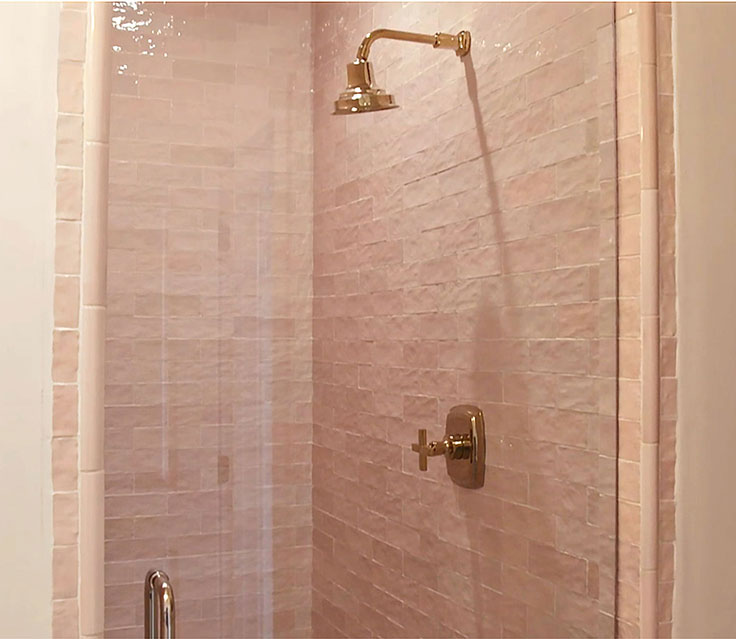 Pink and Gold Shower with Ceramic Subway Tile and Brass Fixtures