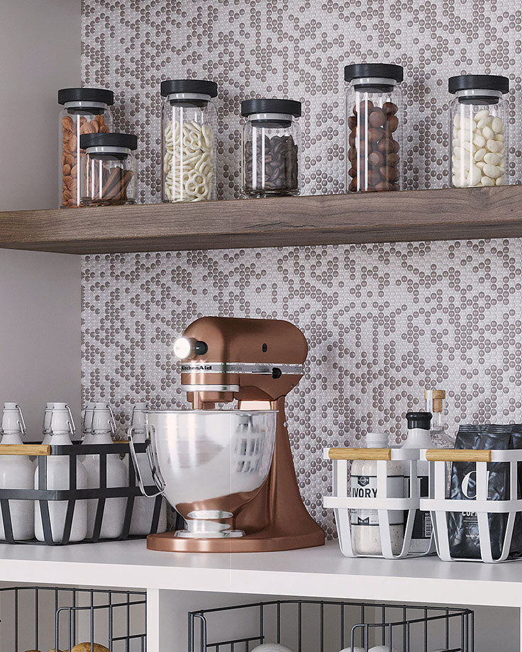 These Cream Penny Recycled Glass Mosaic Tiles add a patterned backsplash to this farmstand pantry design with wire baskets and jar containers for dry goods. Not only are they perfect for this country chic kitchen, but they're low-maintenance and easy to clean!